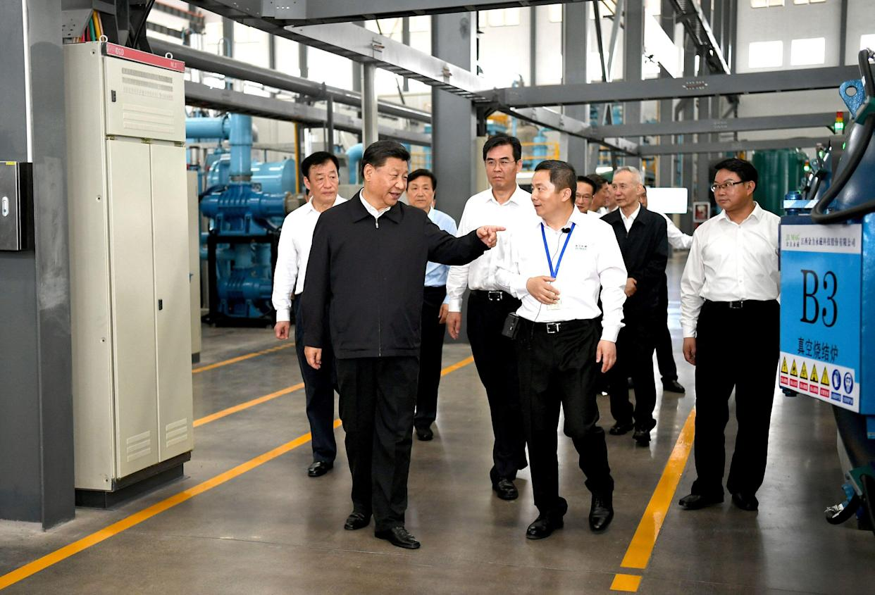 Chinese President Xi Jinping, also general secretary of the Communist Party of China Central Committee and chairman of the Central Military Commission, learns about the production process and operation of the JL MAG Rare-Earth Co. Ltd. as well as the development of the rare earth industry in the city of Ganzhou in east China's Jiangxi Province on May 20, 2019. Xi Jinping visited Jiangxi Province Monday on an inspection tour. (Xinhua/Xie Huanchi) (Xinhua/ via Getty Images)