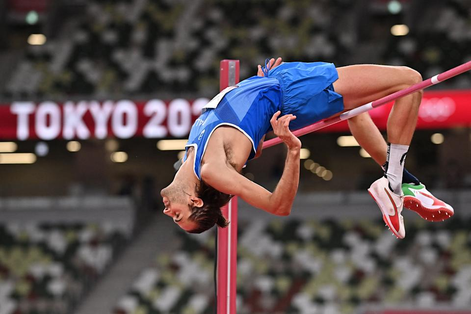 <p>Italy's Gianmarco Tamberi competes in the men's high jump final during the Tokyo 2020 Olympic Games at the Olympic Stadium in Tokyo on August 1, 2021. (Photo by Ben STANSALL / AFP) (Photo by BEN STANSALL/AFP via Getty Images)</p>