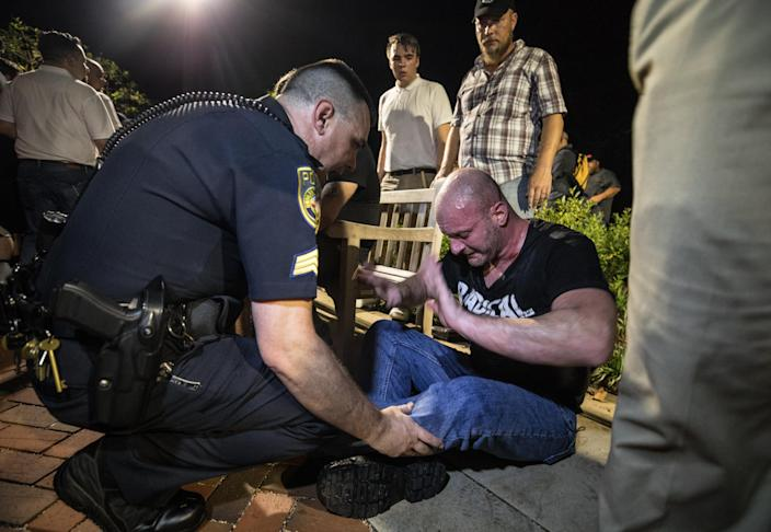 Christopher Cantwell is helped by police after being overcome with tear gas in Charlottesville, Va., Aug. 11, 2017. (Photo: Evelyn Hockstein for The Washington Post via Getty Images)