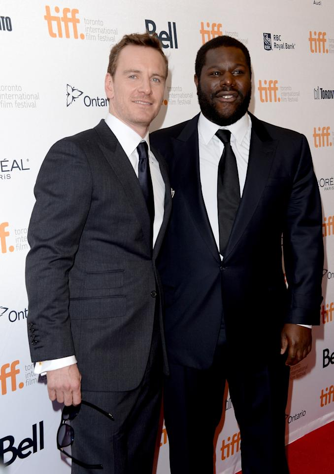 """TORONTO, ON - SEPTEMBER 06: Actor Michael Fassbender (L) and director Steve McQueen arrive at the """"12 Years A Slave"""" premiere during the 2013 Toronto International Film Festival at the Princess of Wales Theatre on September 6, 2013 in Toronto, Canada. (Photo by Jason Merritt/Getty Images)"""