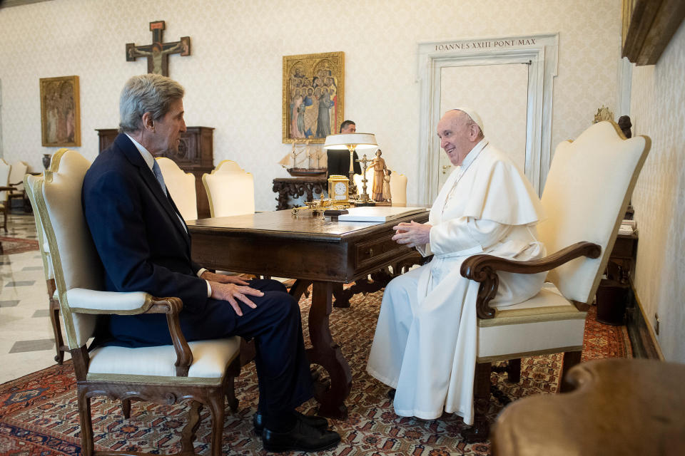 """Pope Francis and John Kerry talk during their meeting at the Vatican, Saturday, May 15, 2021. Former U.S. Secretary of State John Kerry, currently President Biden's envoy on the climate, met in private audience with Pope Francis on Saturday, afterward calling the pope """"a compelling moral authority on the subject of the climate crisis"""" who has been """"ahead of the curve."""" Kerry told Vatican News in an interview that the pope speaks with """"unique authority, compelling moral authority, that hopefull can push people to greater ambition to get the job done. (Vatican Media via AP)"""