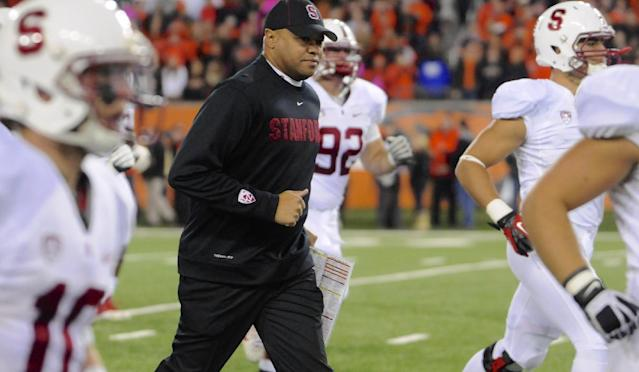 Stanford's head coach David Shaw runs on with his team prior to an NCAA college football game against Oregon State in Corvallis, Ore., Saturday Oct. 26, 2013. Stanford beat Oregon State 20-12. (AP Photo/Greg Wahl-Stephens)
