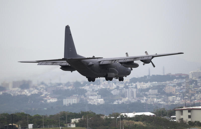 In this Friday, Nov. 30, 2012 photo, a U.S. Air Force MC130 multi-mission plane approaches to land at the U.S. Marine Corps Futenma Air Station in Ginowan, Okinawa, southwestern Japan. About 28,000 U.S. troops, mostly Marines and Air Force, are stationed on Okinawa under a bilateral alliance that's the cornerstone of Tokyo's foreign policy. (AP Photo/Junji Kurokawa)