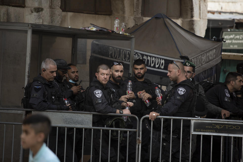 Israeli police stand guard at a checkpoint in the Old City of Jerusalem, Friday, Sept. 10, 2021. Amid increased Israeli-Palestinian tension over a recent prison break, Israeli police said an officer was lightly injured by a firearm in an attempt to thwart a suspected stabbing attack in the area. The Police, which arrested the suspect, did not immediately say how the officer was injured. (AP Photo/Maya Alleruzzo)