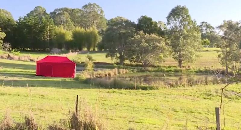 A red tent sits on a rural property at Cootharaba near a dam. It's where Elenore Lindsay, 3, was found dead.