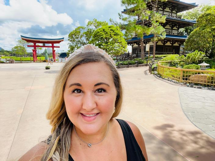carly in front of the japan pavilion at epcot