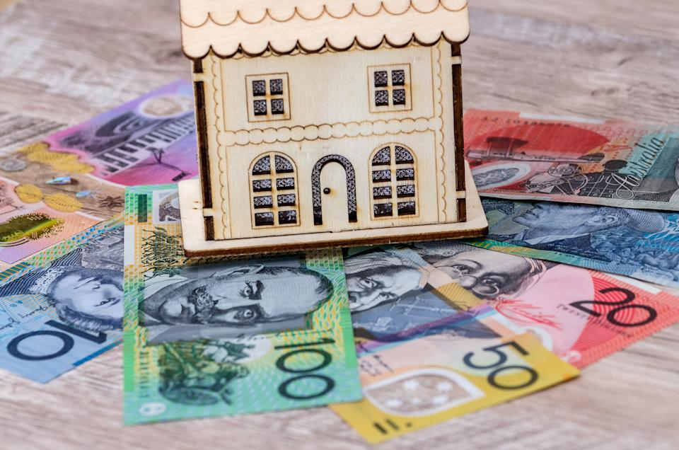 House model with australian dollar banknotes on table