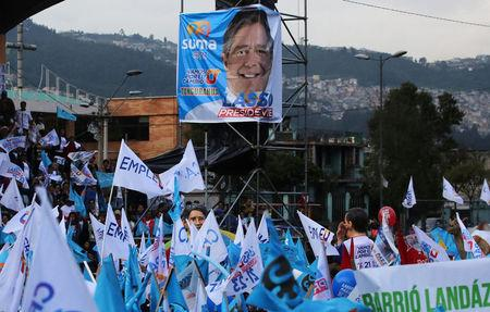 A poster of Guillermo Lasso, presidential candidate from the CREO party, is seen during a campaign rally in Quito, Ecuador, March 29, 2017. REUTERS/Mariana Bazo