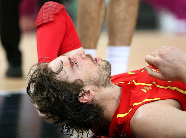 LONDON, ENGLAND - AUGUST 12: Pau Gasol #4 of Spain lies on the court after he was struck in the face during the Men's Basketball gold medal game between the United States and Spain on Day 16 of the London 2012 Olympics Games at North Greenwich Arena on August 12, 2012 in London, England. (Photo by Christian Petersen/Getty Images)