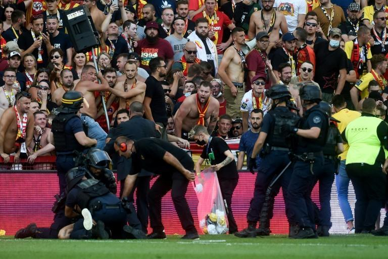 Riot police arrest a man during the trouble in the northern derby between Lens and Lille (AFP/FRANCOIS LO PRESTI)