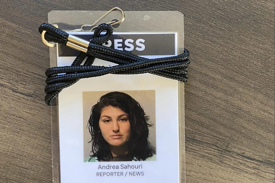 A press badge for Des Moines Register reporter Andrea Sahouri features her jail booking photo from her May 31, 2020 arrest while covering a Black Lives Matter protest. Sahouri is set to stand trial on Monday, March 8. 2021, on misdemeanor charges, a case that prosecutors have pursued despite international condemnation from advocates for press freedom. (Photo courtesy Andrea Sahouri via AP)