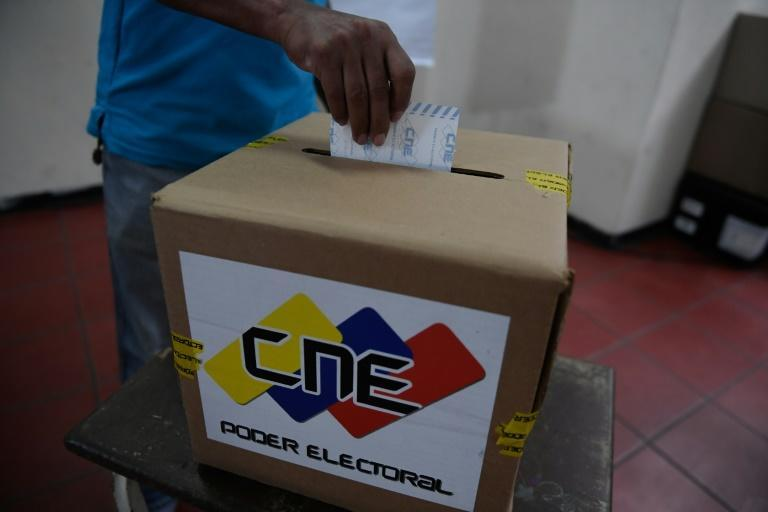 Venezuelans go to the polls on Sunday in legislative elections that are being boycotted by the main opposition parties