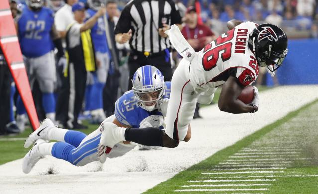 <p>Atlanta Falcons running back Tevin Coleman (26) is taken out of bounds by Detroit Lions strong safety Miles Killebrew (35) during the first half of an NFL football game, Sunday, Sept. 24, 2017, in Detroit. (AP Photo/Rick Osentoski) </p>
