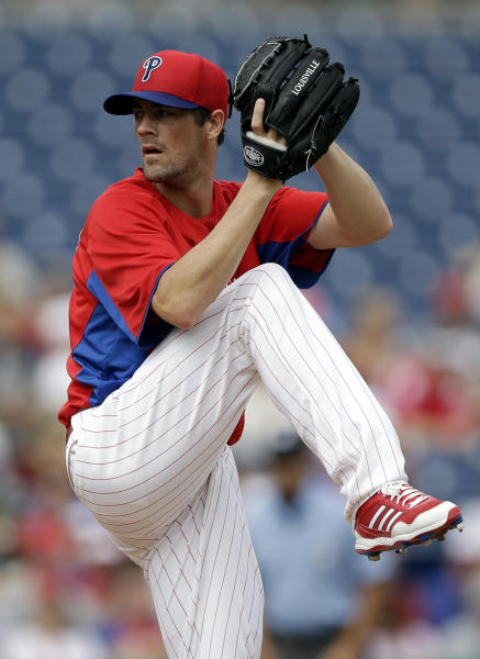 """FILE - In this Feb. 23, 2013, file photo, Philadelphia Phillies pitcher Cole Hamels delivers against the Houston Astros during an exhibition spring training baseball game in Clearwater, Fla. Hamels says it's an """"honor"""" to start on opening day and he'll """"cherish"""" his first assignment when the Phillies begin the season against the Braves at Atlanta on April 1. (AP Photo/Matt Slocum, File)"""