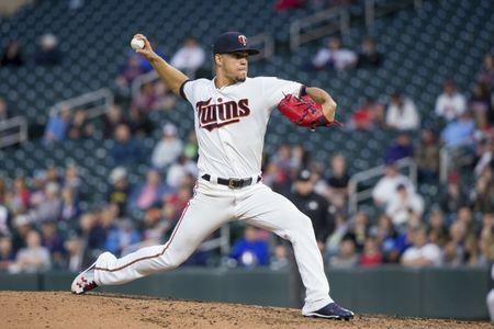 May 21, 2018; Minneapolis, MN, USA; Minnesota Twins starting pitcher Jose Berrios (17) pitches in the fifth inning against Detroit Tigers at Target Field. Mandatory Credit: Brad Rempel-USA TODAY Sports