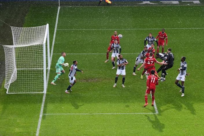 What a moment: Liverpool goalkeeper Alisson Becker heads in the winner against West Brom