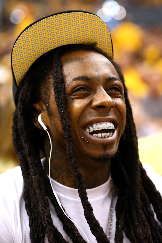 INDIANAPOLIS, IN - JUNE 01: Dwayne Michael Carter Jr. known by his stage name Lil Wayne attends Game Six of the Eastern Conference Finals between the Miami Heat and the Indiana Pacers during the 2013 NBA Playoffs at Bankers Life Fieldhouse on June 1, 2013 in Indianapolis, Indiana. NOTE TO USER: User expressly acknowledges and agrees that, by downloading and or using this photograph, user is consenting to the terms and conditions of the Getty Images License Agreement. (Photo by Ronald Martinez/Getty Images)