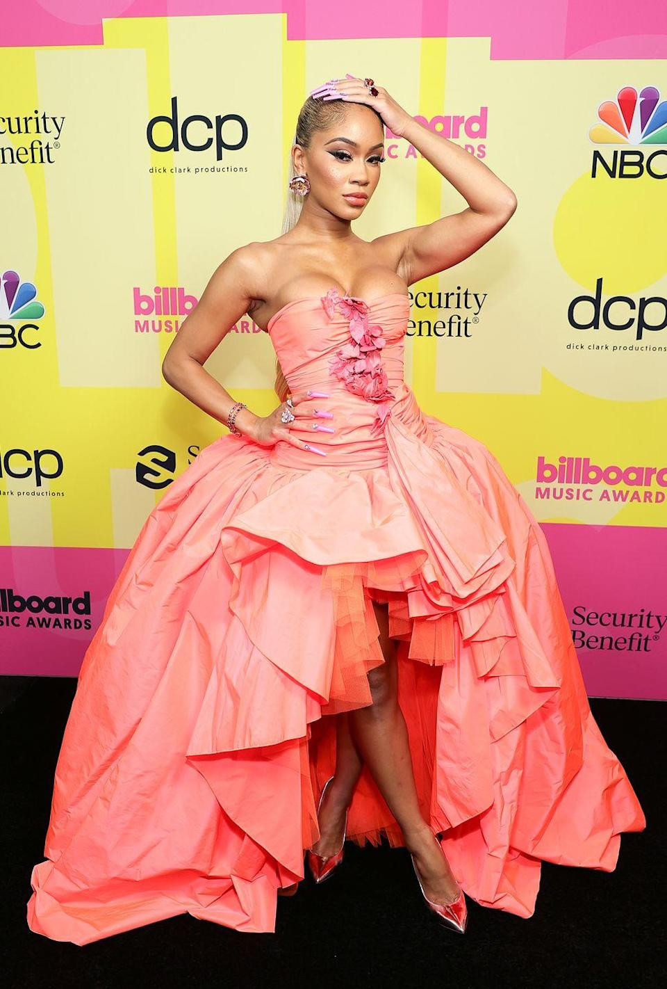 <p><strong>What: </strong>Giambattista Valli<br><br><strong>Why:</strong> The rapper had a full on princess moment on the red carpet in a peach-colored strapless dress from Giambattista Valli. Detailed with ruffles, tulle, and an asymmetric hemline, the star's full gown channeled Marie Antoinette in a major way. She wore her long ponytail slicked back and rocked a pair of point-toe iridescent pumps. </p>