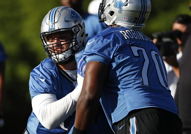 Detroit Lions left tackle Taylor Decker, left, could miss the start of the 2017 season with a shoulder injury. (AP)
