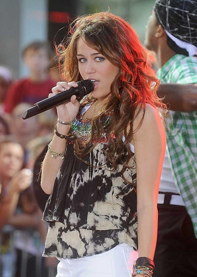 """Miley Cyrus thrilled hundreds of """"Today"""" show fans while performing songs from her new CD on Friday, but disappointed others when an old YouTube video of her mocking fellow Disney stars Demi Lovato and Selena Gomez resurfaced in the media. Miley later apologized in Popstar! magazine, saying she was """"super sorry."""" Jamie McCarthy/<a href=""""http://www.wireimage.com"""" target=""""new"""">WireImage.com</a> - July 25, 2008"""