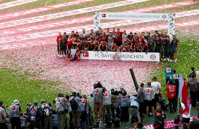 Soccer Football - Bundesliga - Bayern Munich v VfB Stuttgart - Allianz Arena, Munich, Germany - May 12, 2018 General view of Bayern Munich players celebrating winning the Bundesliga with the trophy REUTERS/Michaela Rehle DFL RULES TO LIMIT THE ONLINE USAGE DURING MATCH TIME TO 15 PICTURES PER GAME. IMAGE SEQUENCES TO SIMULATE VIDEO IS NOT ALLOWED AT ANY TIME. FOR FURTHER QUERIES PLEASE CONTACT DFL DIRECTLY AT + 49 69 650050