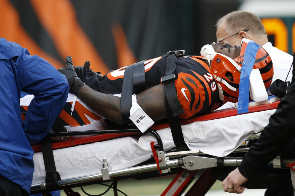 Cincinnati Bengals cornerback Tony McRae (29) is taken off the field after an injury in the second half of an NFL football game against the Cleveland Browns, Sunday, Nov. 25, 2018, in Cincinnati. (AP Photo/Frank Victores)