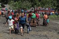 People walk at a school used as temporary shelter for residents of neighbouring villages affected by mudslides, in the village of Santa Elena