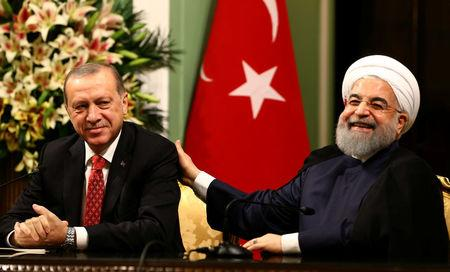 Turkish President Erdogan and Iranian President Rouhani are seen during a joint news conference in Tehran