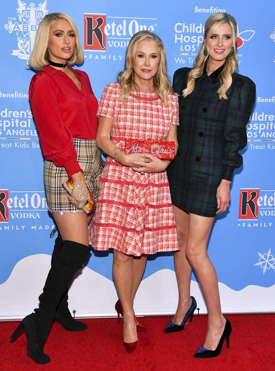 <p>Kathy Hilton is flanked by daughters Paris and Nicky on Sept. 21 at the 16th annual toy drive for Children's Hospital LA at The Abbey Food & Bar in West Hollywood. </p>