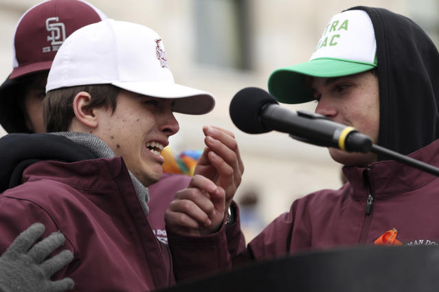 <p>Joseph Zenobi, left, a student from Marjory Stoneman Douglas in Parkland, Fla. broke down crying as he spoke about his friends who were killed during a rally against gun violence Saturday at the State Capitol in St. Paul, Minn., as part of the national March for Our Lives event. (Anthony Souffle/Star Tribune via AP) </p>