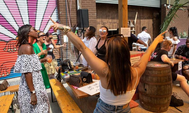 """People party whilst staying in their """"bubbles"""", at a """"UKG Brunch Presents: UKG Big BBQ """" event"""