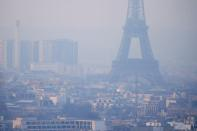 FILE PHOTO: The Eiffel Tower is surrounded by a small-particle haze which hangs above the skyline in Paris