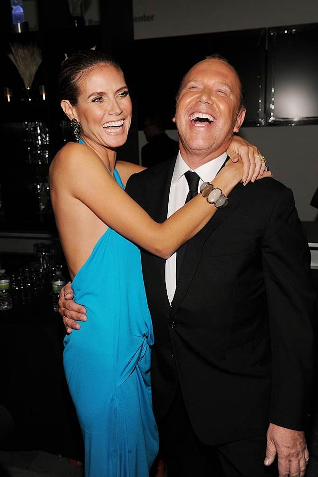 "Inside the soiree, Heidi shared a hearty laugh with her ""Project Runway"" pal/designer Michael Kors, who received the amfAR Award of Courage for his leadership in the fight against AIDS. Dimitrios Kambouris/<a href=""http://www.wireimage.com"" target=""new"">WireImage.com</a> - June 14, 2011"