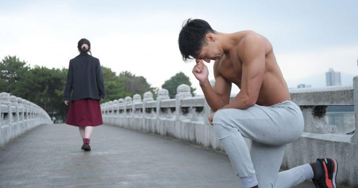 "A man kneels ""Thinker-style"" after being rejected by a girl. (Photo courtesy of freephotomuscle.com)"