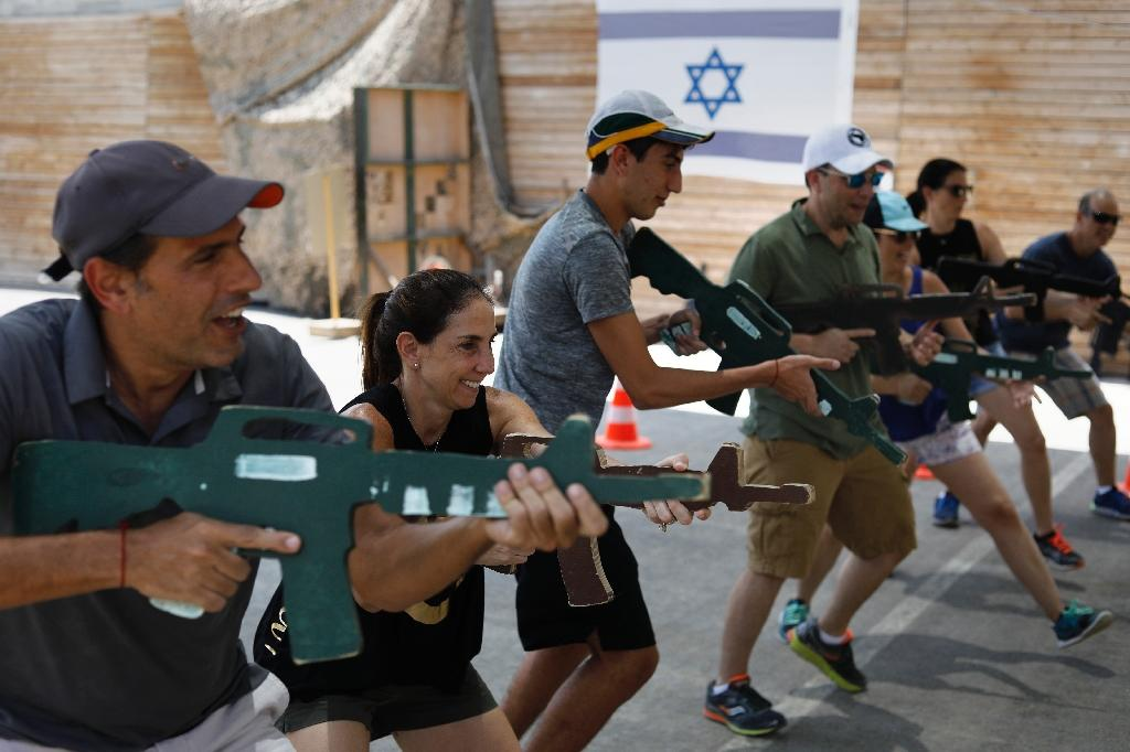 "Foreign tourists train with wooden guns during an ""anti-terrorism"" course in the West Bank on July 18, 2017 (AFP Photo/MENAHEM KAHANA)"