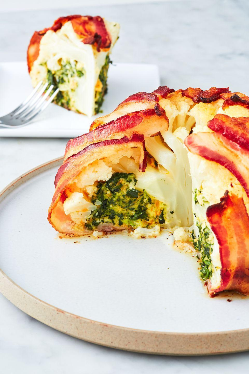 """<p>Just a little spinach dip stuffed in there.</p><p>Get the recipe from <a href=""""https://www.delish.com/cooking/recipe-ideas/a26882653/bacon-wrapped-cauliflower-recipe/"""" rel=""""nofollow noopener"""" target=""""_blank"""" data-ylk=""""slk:Delish"""" class=""""link rapid-noclick-resp"""">Delish</a>.</p>"""
