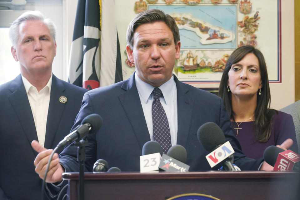 Florida Governor Ron DeSantis speaks at a news conference related to the situation in Cuba, Thursday, Aug. 5, 2021, in Hialeah Gardens, Fla. To the left is House Minority leader Kevin McCarthy and to the right is Lt. Governor Jeanette Nunez. (AP Photo/Marta Lavandier)