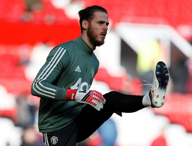 "Soccer Football - Premier League - Manchester United vs Chelsea - Old Trafford, Manchester, Britain - February 25, 2018 Manchester United's David De Gea warms up before the match REUTERS/Andrew Yates EDITORIAL USE ONLY. No use with unauthorized audio, video, data, fixture lists, club/league logos or ""live"" services. Online in-match use limited to 75 images, no video emulation. No use in betting, games or single club/league/player publications. Please contact your account representative for further details."
