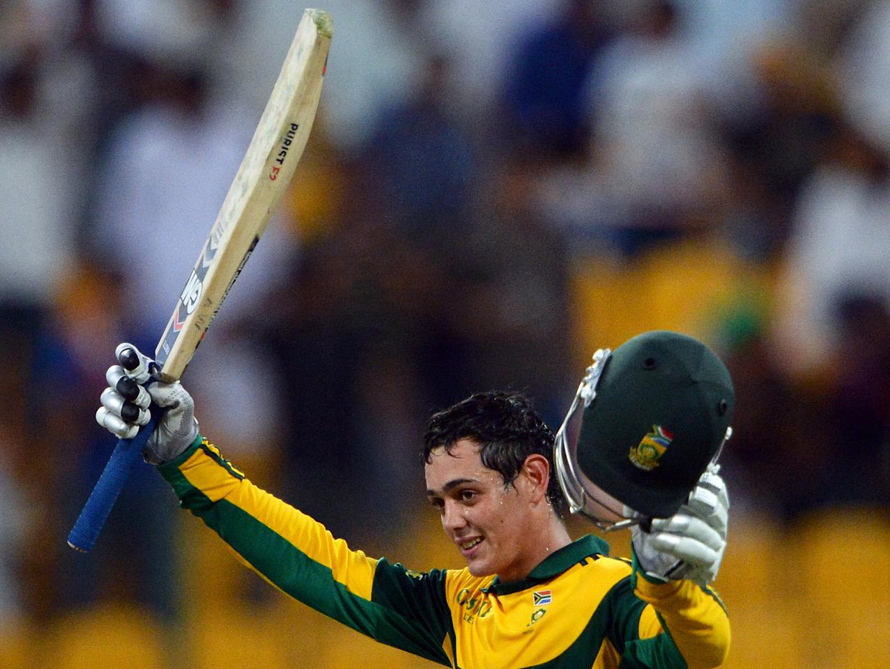 South African opener batsman Quinton de Kock celebrates after make his century (100) runs during fourth day-night international in Sheikh Zayed Cricket Stadium in Abu Dhabi on November 8, 2013.  South African captain AB de Villiers won the toss and decided to bat. South Africa lead the five-match series with 2-1. AFP PHOTO/ Asif HASSAN        (Photo credit should read ASIF HASSAN/AFP/Getty Images)