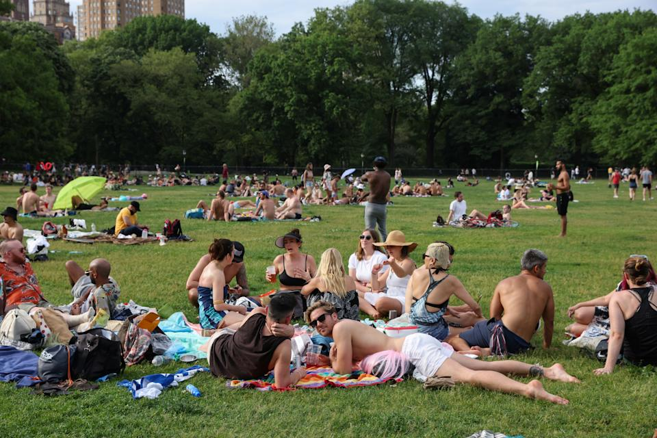 People enjoy socializing without masks in Central Park in the Manhattan borough of New York City, on May 23, 2021. (Caitlin Ochs/Reuters)
