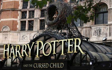 A display hangs outside The Palace Theatre where the Harry Potter and The Cursed Child play is being staged, in London