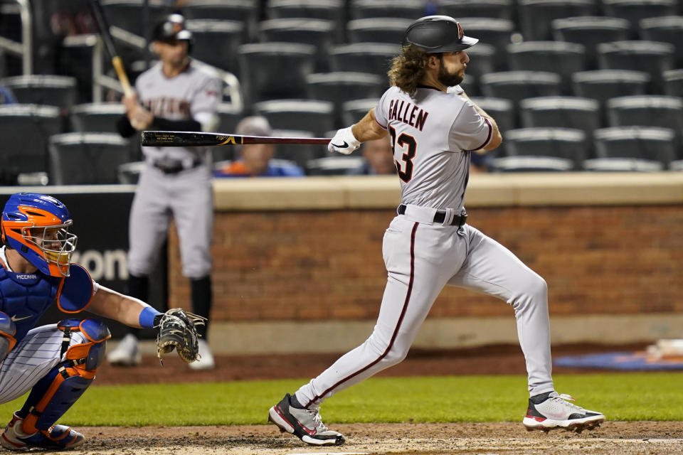 Arizona Diamondbacks' Zac Gallen follows through on a ground ball off New York Mets relief pitcher Robert Gsellman, driving in a run during the third inning of a baseball game, Friday, May 7, 2021, in New York. A runner was forced at second on the play. (AP Photo/John Minchillo)