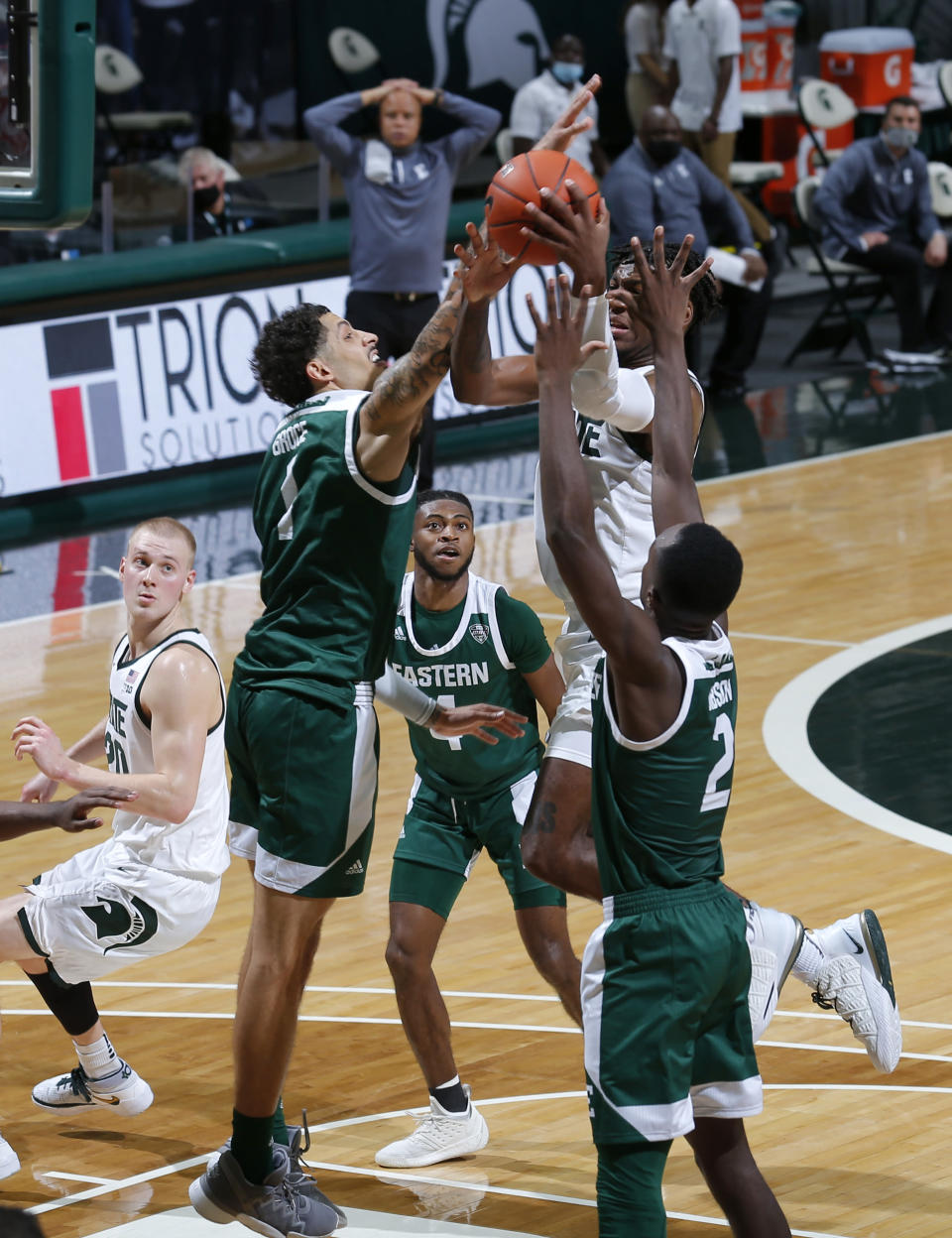 Michigan State's Aaron Henry, right, goes to the basket against Eastern Michigan's Ty Groce, left, and Miles Gibson (2) during the second half of an NCAA college basketball game Wednesday, Nov. 25, 2020, in East Lansing, Mich. Michigan State won 83-67. (AP Photo/Al Goldis)