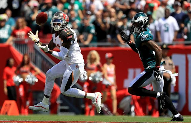 <p>DeSean Jackson #11 of the Tampa Bay Buccaneers catches a touchdown pass during a game against the Philadelphia Eagles at Raymond James Stadium on September 16, 2018 in Tampa, Florida. (Photo by Mike Ehrmann/Getty Images) </p>