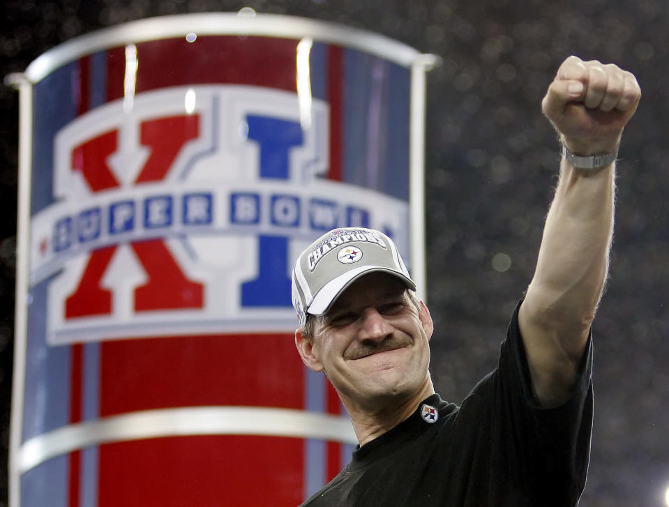 FILE - Pittsburgh Steelers head coach Bill Cowher reacts on the center stage after the Steelers' 21-10 win over the Seattle Seahawks in the Super Bowl XL football game in Detroit, in this Sunday, Feb. 5, 2006, file photo. Cowher, who won 149 games and a Super Bowl in 15 seasons with the Pittsburgh Steelers from 1992-2006, will be inducted into the Pro Football Hall of Fame next month. (AP Photo/David J. Phillip, File)