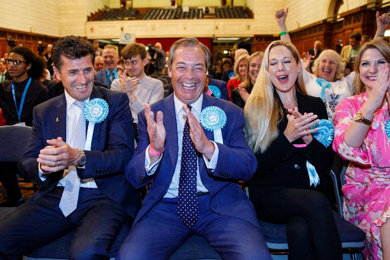 Nigel Farage (centre) hopes his Brexit Party can build on its success in the European Parliament elections to win a seat in the British parliament on Thursday in Peterborough (AFP Photo/TOLGA AKMEN)
