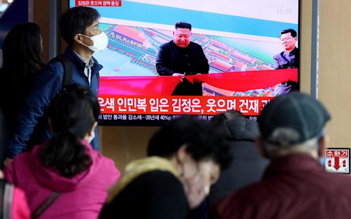 People watch a television broadcast reporting an image of North Korean leader Kim Jong-un in Seoul, South Korea - Getty