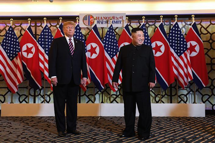 US President Donald Trump (L) and North Korea's leader Kim Jong Un arrive for a meeting at the Sofitel Legend Metropole hotel in Hanoi (SAUL LOEB/AFP/Getty Images)