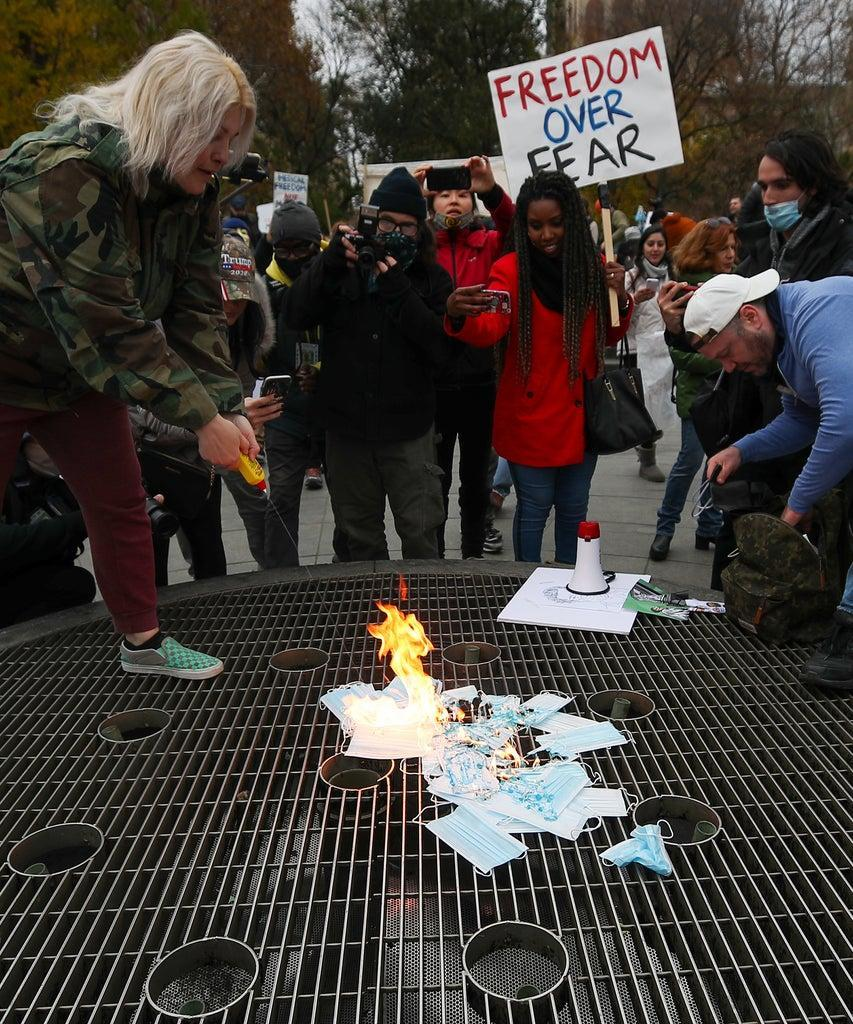 NEW YORK, USA – NOVEMBER 22: A group of Trump supporters burned face masks at the Washington Square Park as they protest coronavirus (COVID-19) measurements in New York City, United States on November 22, 2020. (Photo by Tayfun Coskun/Anadolu Agency via Getty Images)