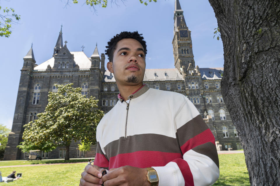 """Shepard Thomas, a recent Georgetown University graduate and a descendant of slaves sold by Jesuits to keep the school open, poses for a portrait on the campus in Washington on Thursday, May 6, 2021. One of the main concerns is how funds committed to reparations work will be spent, and whether slave descendants will have adequate say in the process, according to Thomas. """"The fear is that the university will use these funds for their own purposes,"""" the 23-year-old New Orleans native said. """"The university is trying to control the narrative, and we're trying to prevent that."""" (AP Photo/Jacquelyn Martin)"""